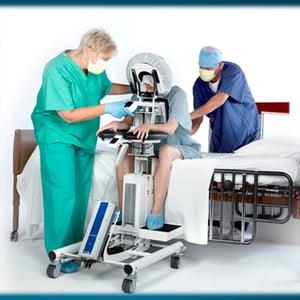 Patient leaning against EPD for epidural procedure