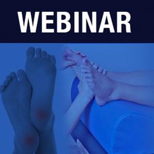 Webinar with feet on reflexology bolster