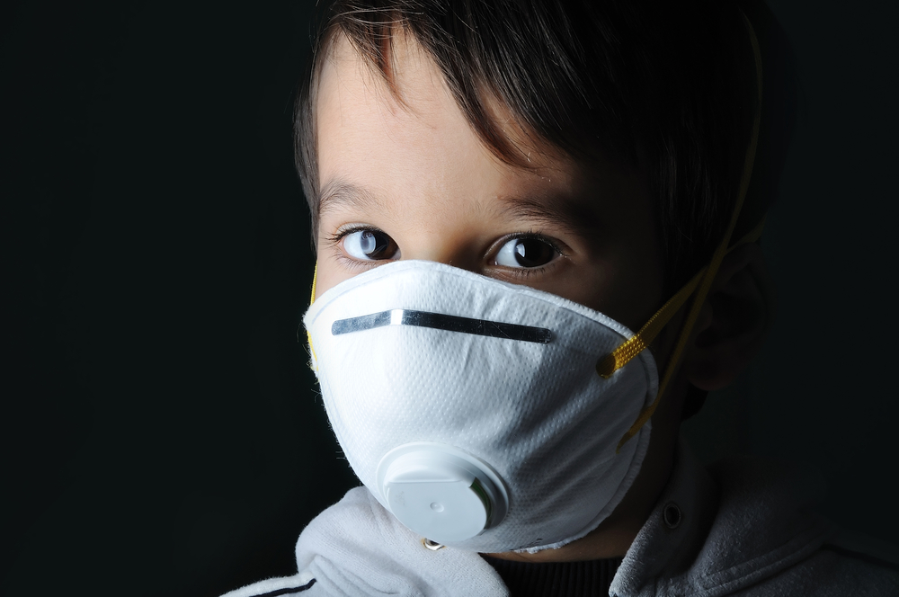 Kid wearing a mask in the dark-1